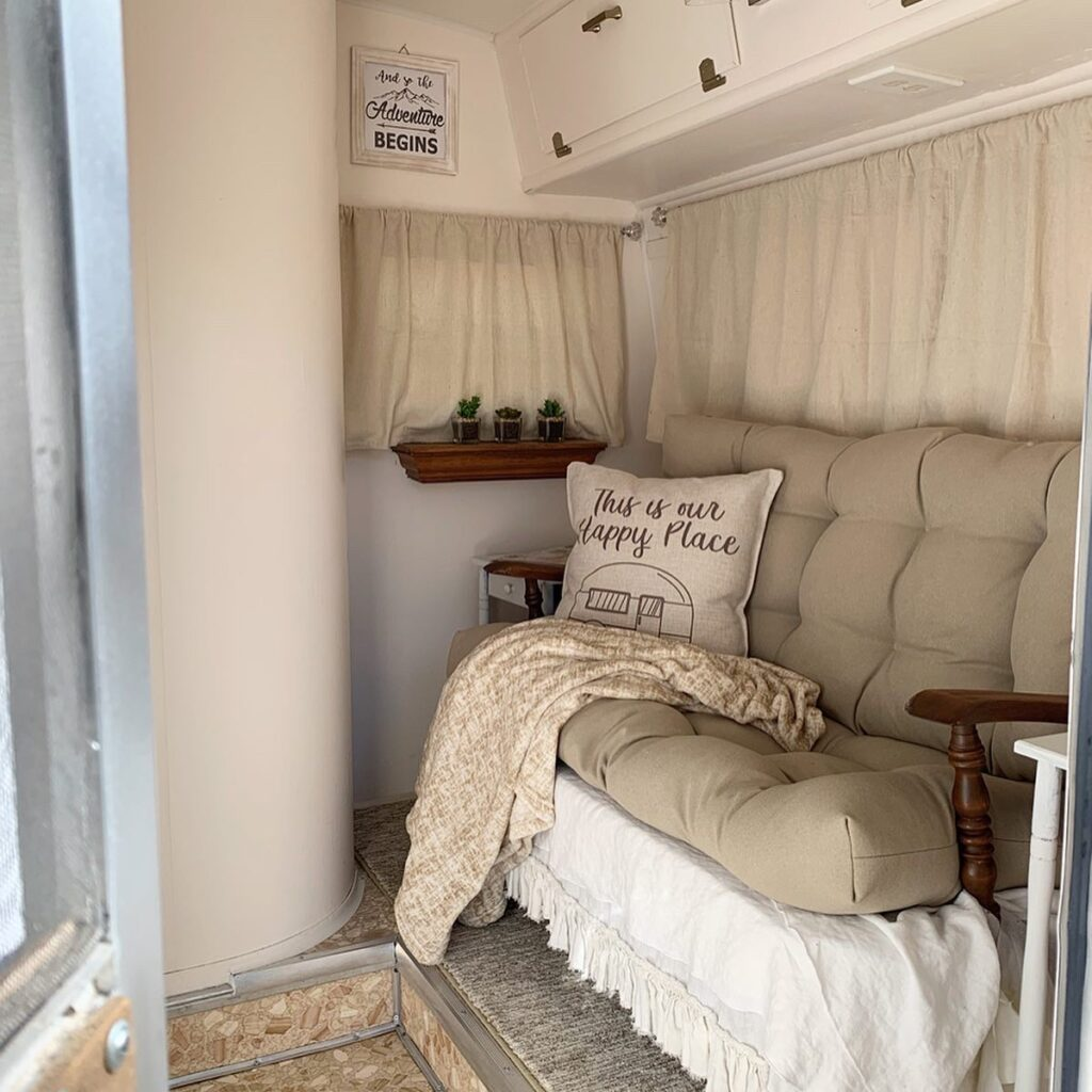 vintage settee with neutral cushions for small camper