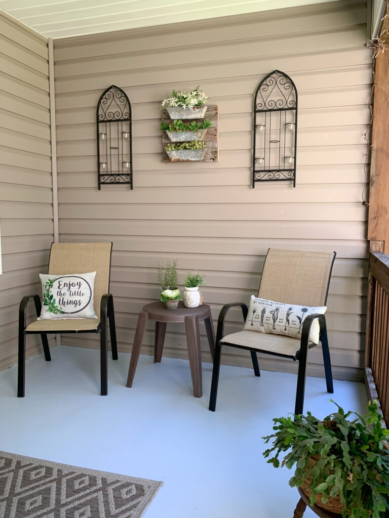 Seating area of porch with comfortable straight chairs from Ollie's