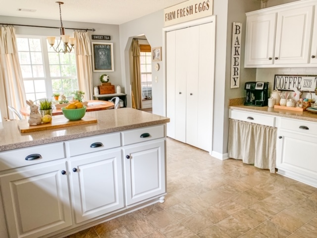 Cottage style kitchen in white, white kitchen cabinets, painting a kitchen white