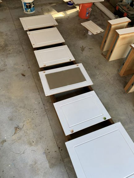 painting maple cabinets white, painted cabinets, painting kitchen cabinets, white kitchen cabinets