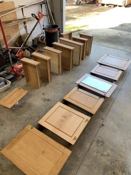 maple cabinets being sanded, sanding kitchen cabinets, sanding cabinets