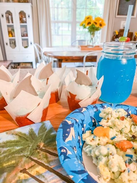 shark themed party food, shark week, party food, shark float drink, shark cupcakes, shark bait popcorn