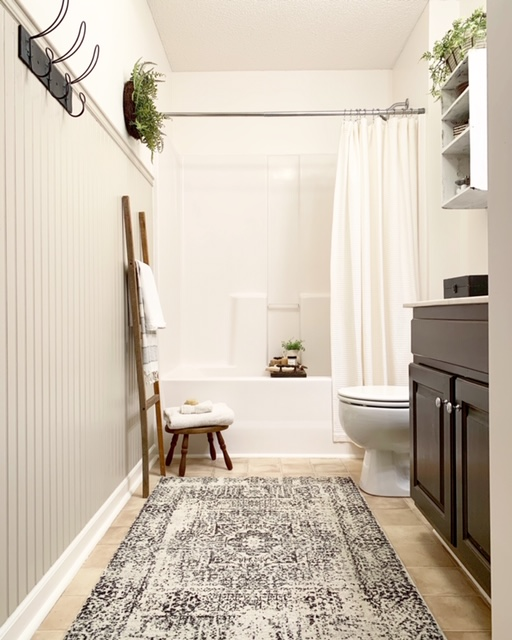 A cottage style bathroom with bead board wall treatment