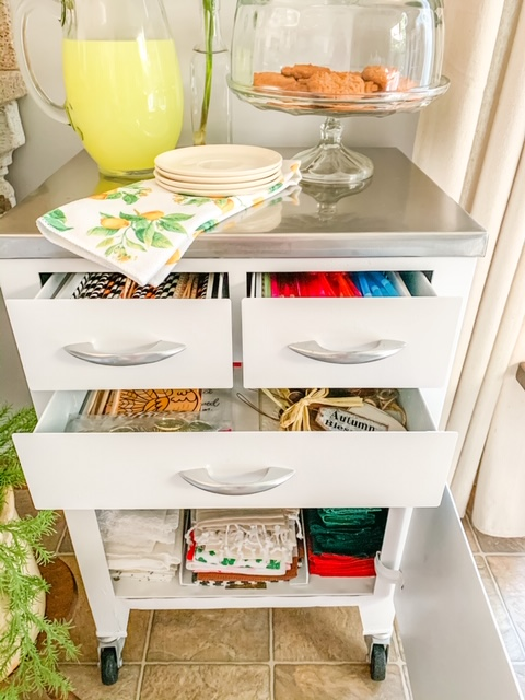 a vintage medical cabinet used for storing entertaining supplies