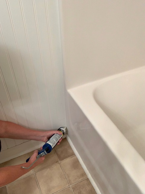 Caulk the seams of bead board wall treatment