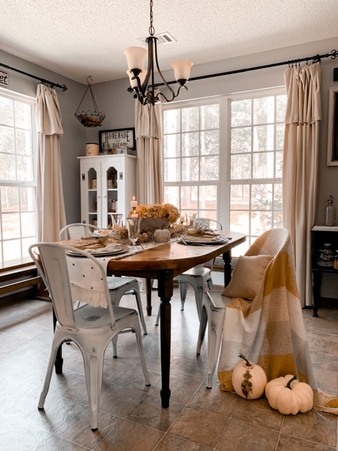 a neutral fall table setting in a cozy kitchen