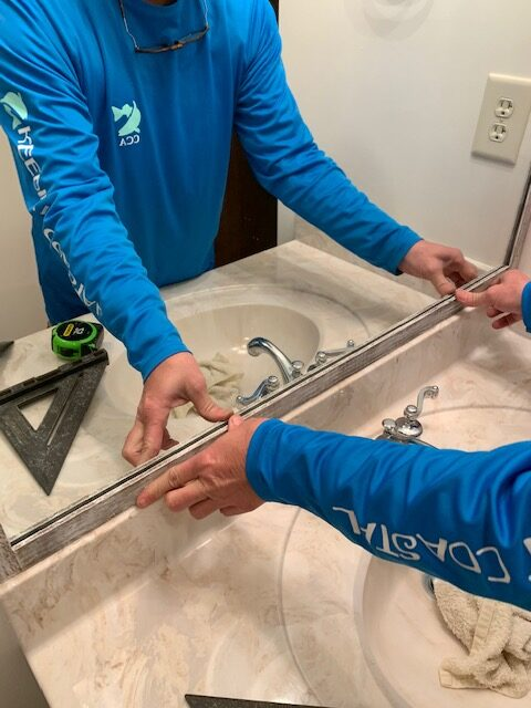 a diy tutorial for framing a bathroom wall mirror