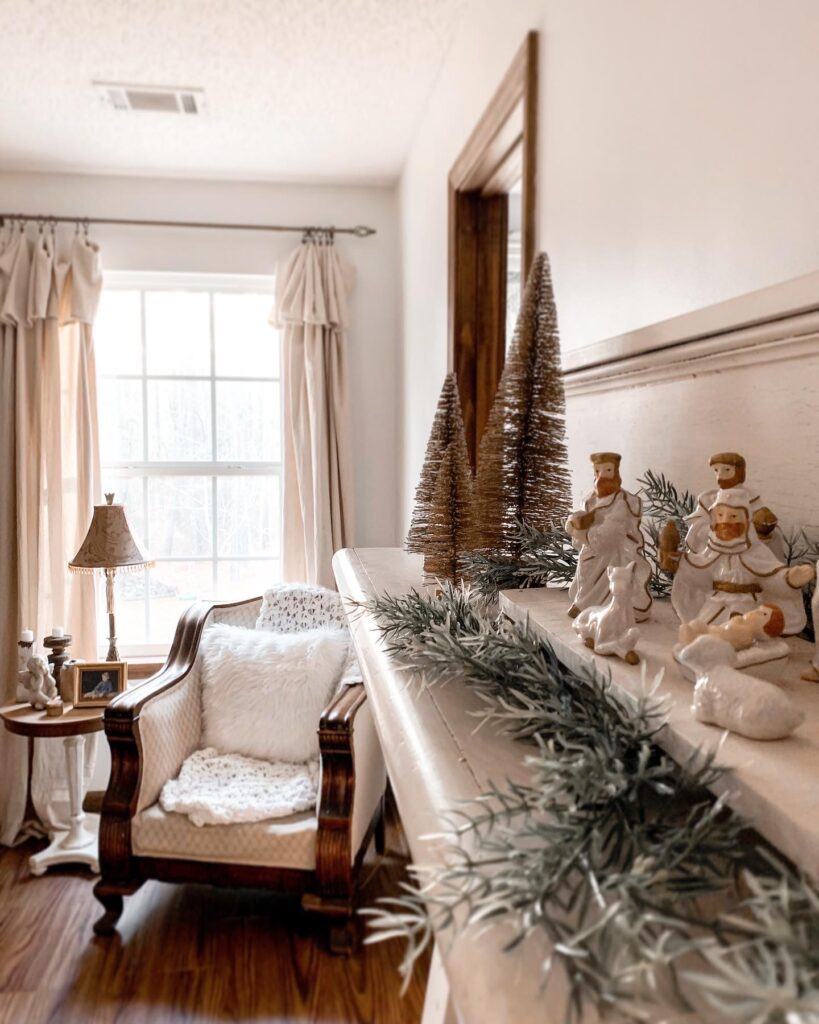 antique mantel decorated for Christmas in cottage bedroom