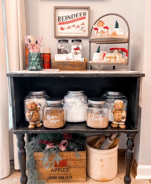 Christmas hot cocoa bar decorated with vintage santa mugs