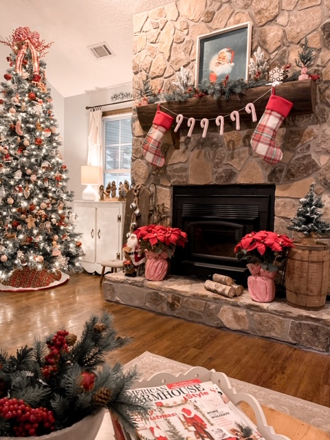 A cozy cottage Christmas living room with rustic mantel