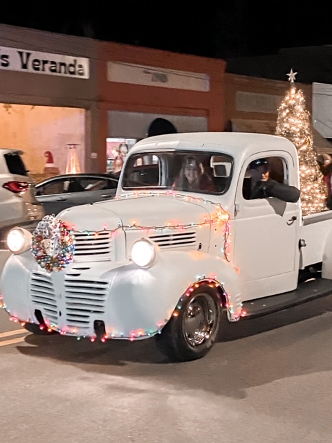 vintage pickup truck in mistletoe madness Christmas parade