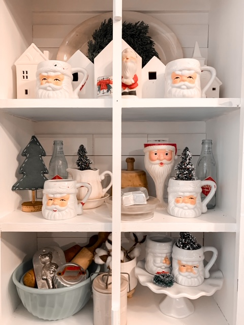 vintage Santa collection in pie safe