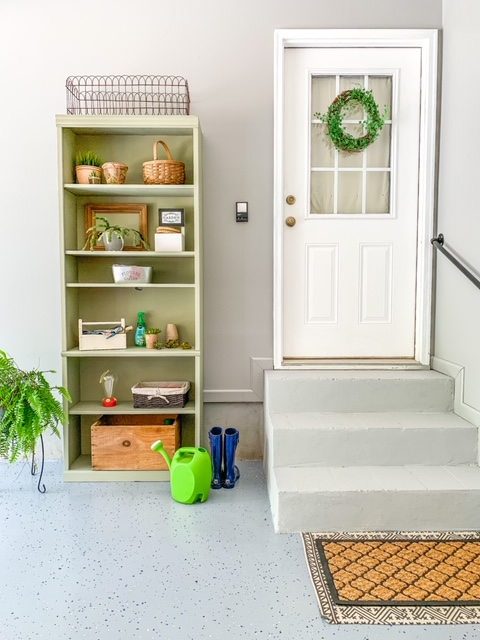 A garage entry makeover with a gardening shelf station