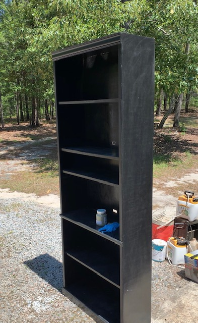 A before picture of an old book case repurposed for a gardening station