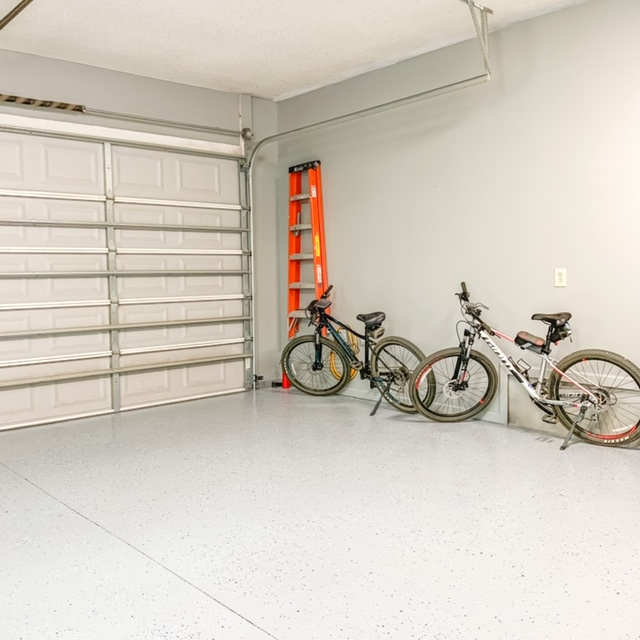 A clean and organized garage leaves room for bicycle storage
