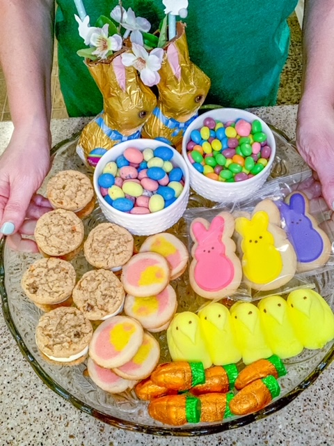 An Easter dessert tray using chocolate bunnies, jelly beans, and marshmallow peeps