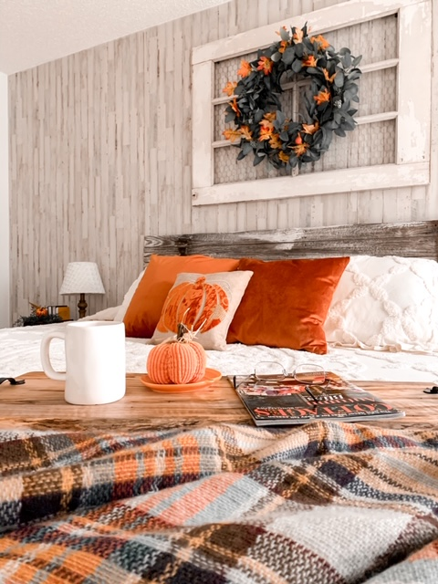 A cozy cottage bedroom styled with the colors of fall