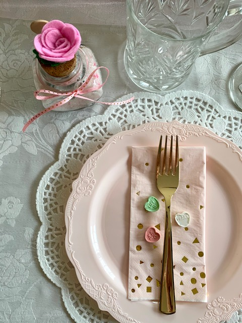 A pretty table place setting for a Galentine's Day brunch