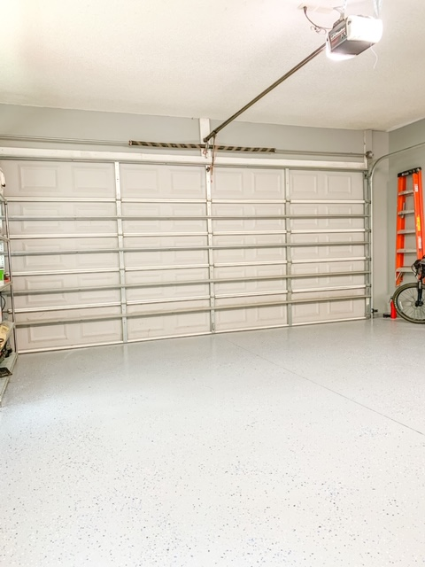 A clean garage floor made new with epoxy shield floor kit