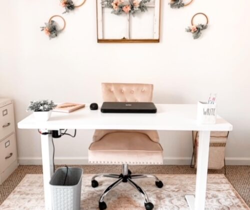 A cottage style home office featuring beautiful blush tones