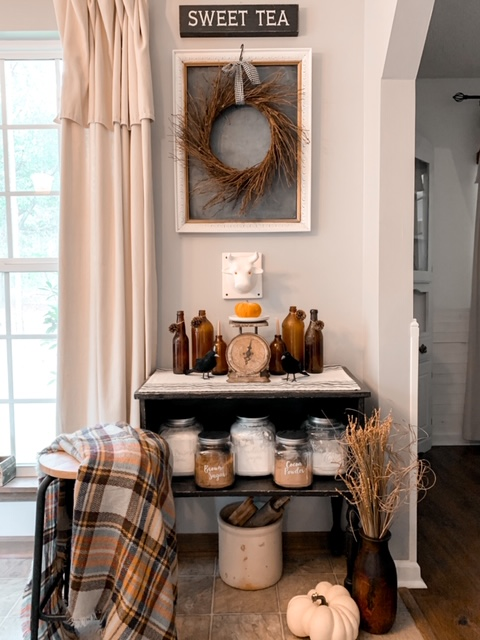 A farmhouse style kitchen baking station decorated for the fall season