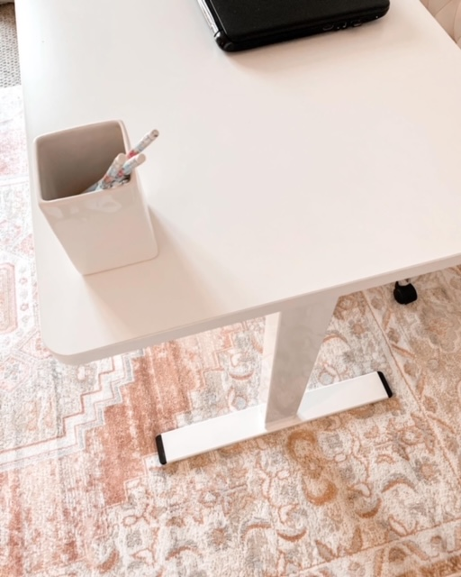 A white Flexispot Standing desk looks lovely in this cottage style home office