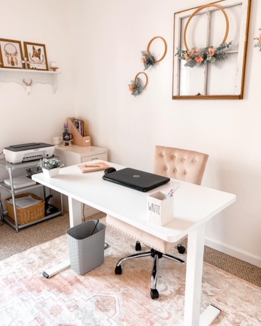 A cottage style home office decorated with blush tones