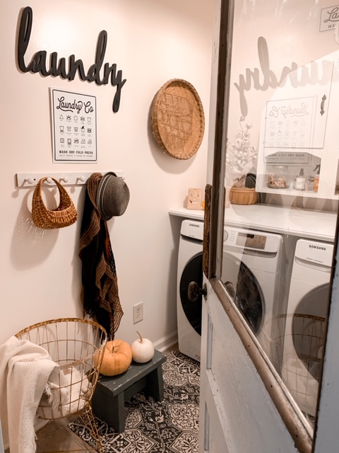 A farmhouse style laundry room decorated for fall