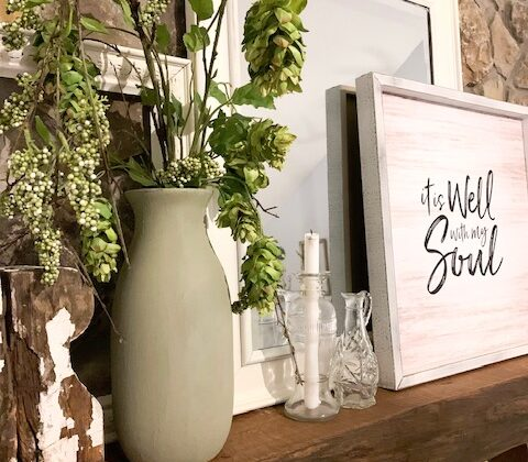 A rustic cottage mantel decorated for spring