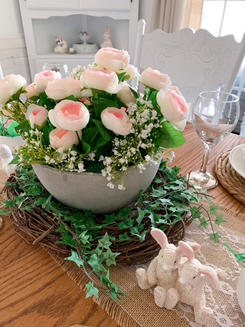 Pink faux ranunculus are a beautiful choice for an Easter table centerpiece