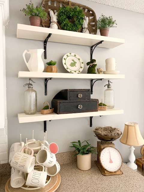 Kitchen open shelves styled for spring with bunnies and vintage finds