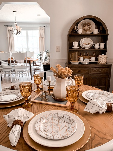 An early fall table scape is styled with amber glass and other thrifted finds