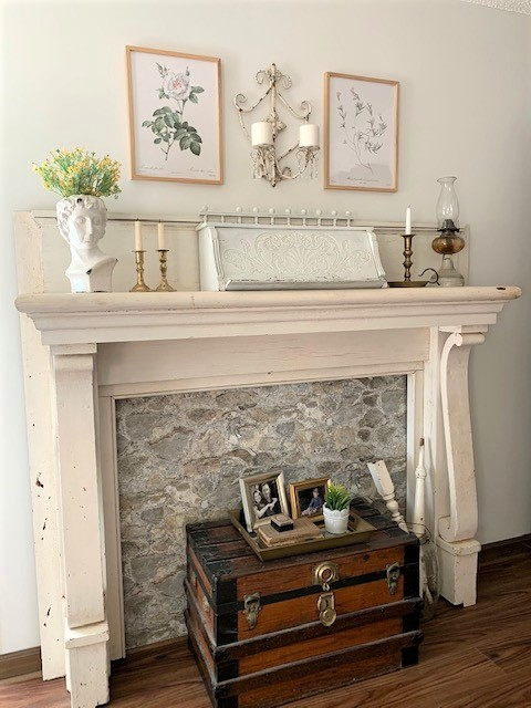 An antique mantel styled with vintage inspired home decor