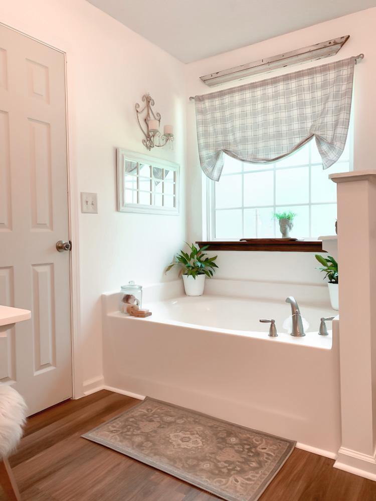 soaking tub in cottage style bathroom