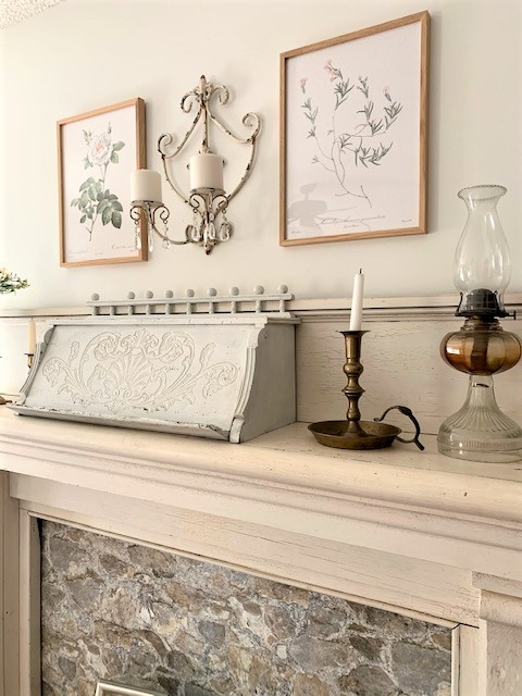 vintage inspired decor on an antique mantel