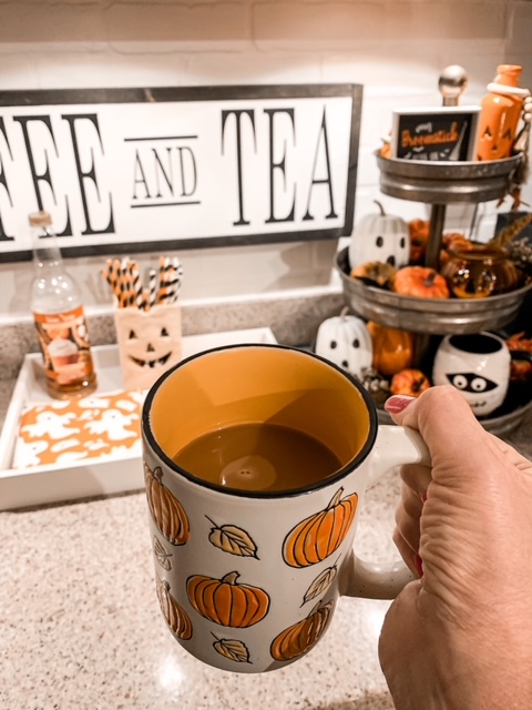 coffee bar styled for fall with a Halloween themed tier tray