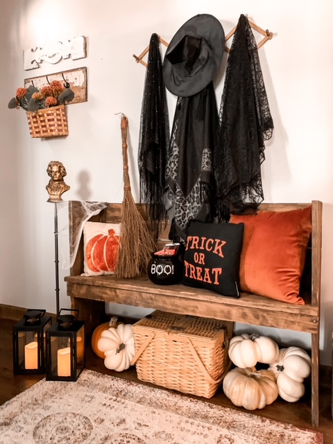a front foyer styled for the fall season and Halloween with a place for the witch to park her broom and leave her hat and cape