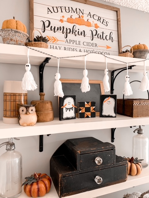 kitchen open shelves styled for Halloween with cute spooky decor and vintage finds